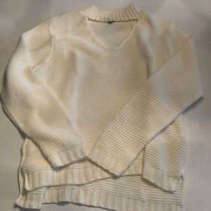 Charlotte Russe cream sweater with v-neck cutout